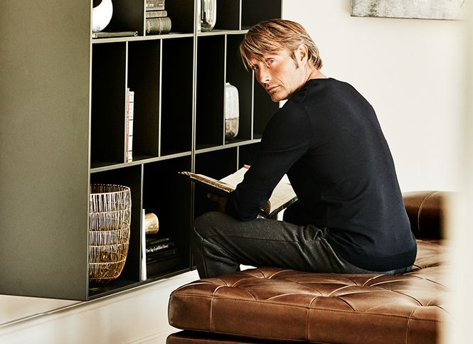 Mads Mikkelsen reading on the fusion day bed