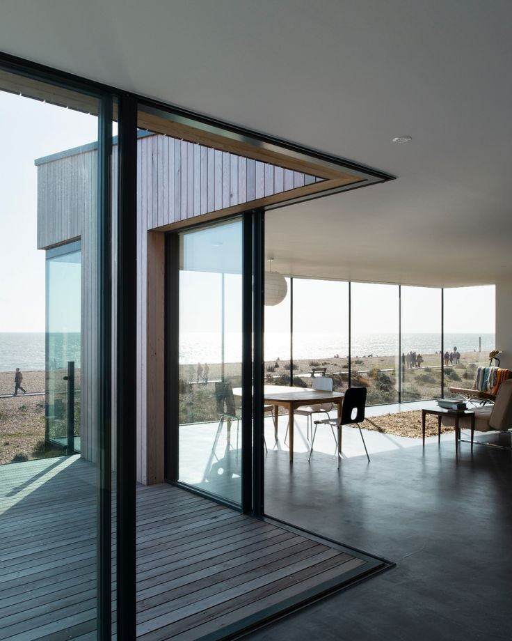Open corner glass sliding doors were installed onto this coastal new build to maximise the natural light into the home and maximise the beach front views.