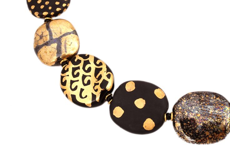 Gorgeous Kazuri beads hand made from earthen clay and fired and hand painted by Kenyan women.