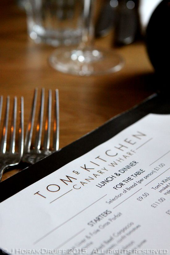 A review of Tom's Kitchen (Canary Wharf), a chic urban deli-bar and the first east London outpost of Michelin-starred chef Tom Aikens' restaurants.