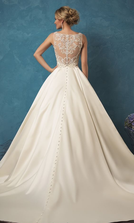 Glamorous crystal beaded top ballgown wedding dress; Featured Dress: Amelia Sposa