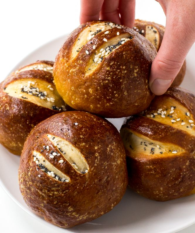 Homemade Pretzel Rolls baked to perfection and topped with sesame seeds, salt and poppy seeds. They are a lot easier to make at home than you think!