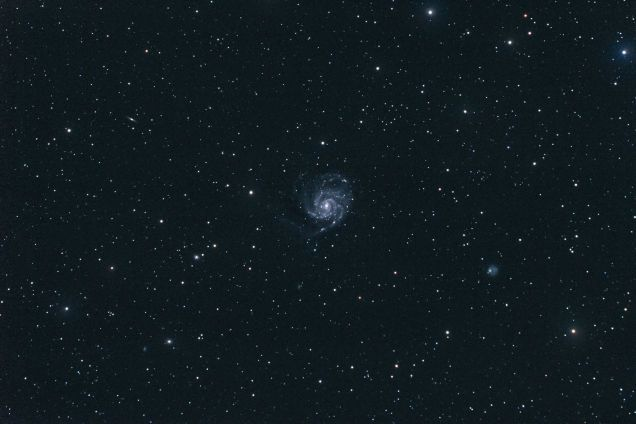 This is an uncommonly beautiful image of M101, the Pinwheel Galaxy, captured by photographer John Purvis on a clear night. It's a rare gem, because M101 is especially difficult to photograph, being so far away and so faint. It requires long exposures, and a lot of patience.