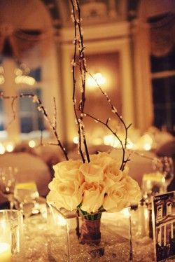 White Rose Branch Centerpiece I think this would be great as a Holiday wedding centerpiece.