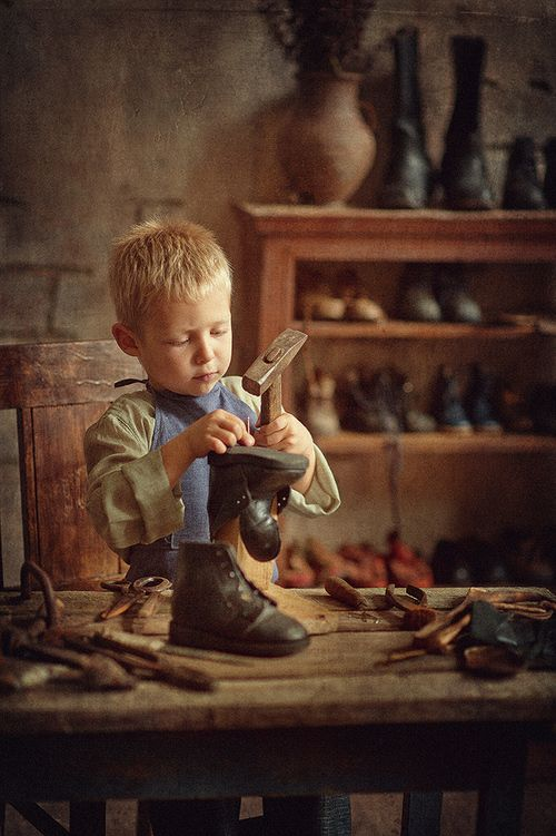 Boy learning to be a cobbler