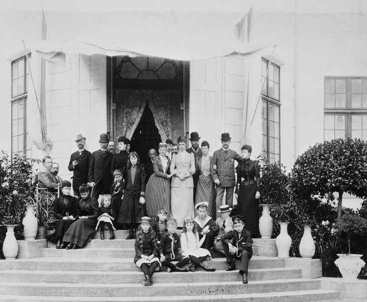 Group photograph at Bernstorff, from left to right. Front group of children: Princess Alexandra of Cumberland; Princess Thyra of Denmark; Prince Christian of Cumberland; Grand Duchess Olga and Grand Duke Michael of Russia; Prince Harald of Denmark; Prince George William of Cumberland. Seated group, left: Prince George of Greece and Prince Waldemar of Denmark (on seat); Princess Maud of Wales; Grand Duches Xenia of Russia and Princess Olga of Cumberland (on step).Standing: Ernest Augustus…