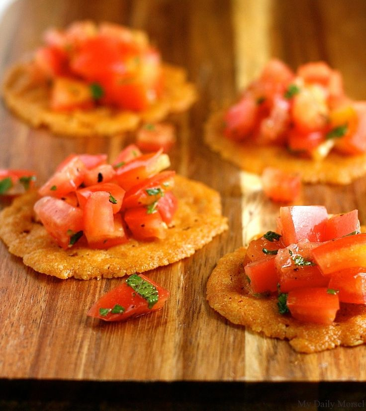 Parmesan Crisps with Heirloom Tomato Salad Not quite a bread, but very close.. Ingredients 6 tablespoons grated Parmesan cheese 1 1/2 tablespoons unsalted butter, at room temperature 1 tablespoon + 2 teaspoons all-purpose flour 2 large heirloom tomatoes, seeded and diced 2 tablespoons chopped basil leaves 2 teaspoons extra-virgin olive oil Kosher salt Freshly ground black pepper