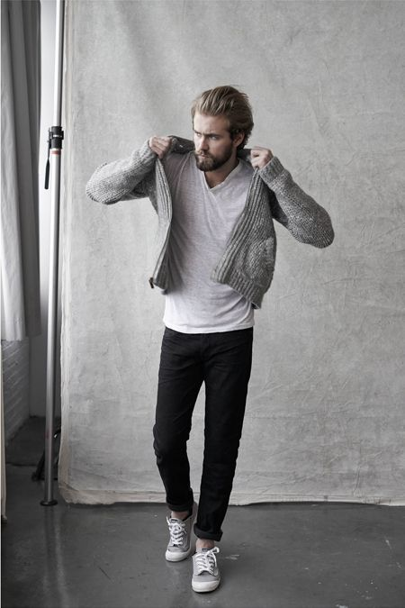 A grey zip sweater and black chinos feel perfectly suited for weekend activities of all kinds. Grey low top sneakers will add some edge to an otherwise classic look.  Shop this look for $116:  http://lookastic.com/men/looks/grey-v-neck-t-shirt-grey-zip-sweater-black-chinos-grey-low-top-sneakers/6311  — Grey V-neck T-shirt  — Grey Zip Sweater  — Black Chinos  — Grey Low Top Sneakers