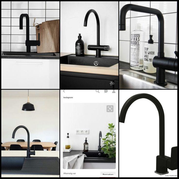 Zwarte kraan in de keuken op een zwart aanrechtblad met zwarte gootsteen. Greeploos witte keuken. Witjes van wand tot op en aan de schappen.