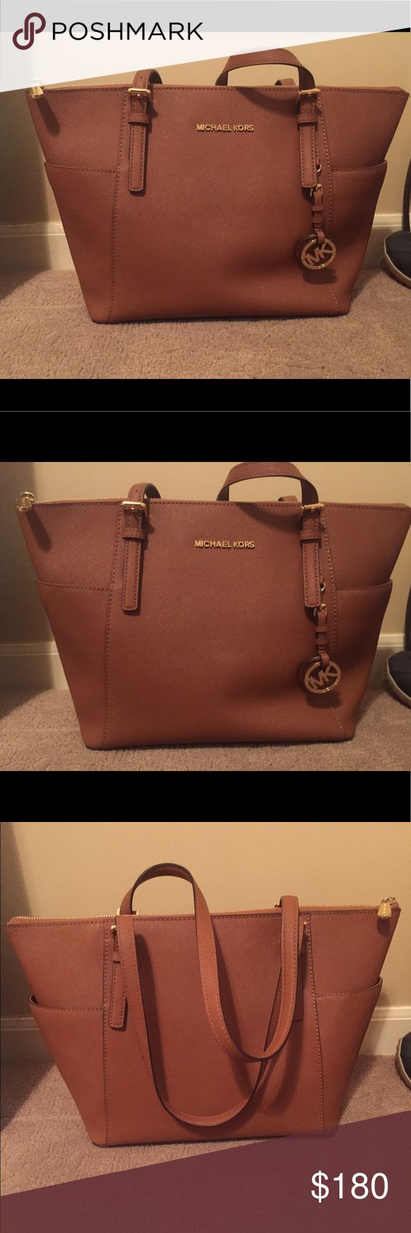 Michael Kors Jet Set Large Top Zip  Leather Tote Very good condition, only used once or twice, no scuff marks or stains or tears or rips. In the luggage color. Authentic from the Michael Kors store. Comes with dust bag. Michael Kors Bags Totes