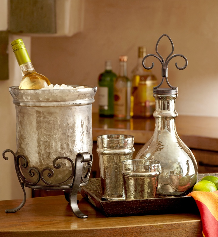 Pier 1 Fleur de Lis Hammered Decanter and Glass Wine Chiller make stunning additions to the dining area