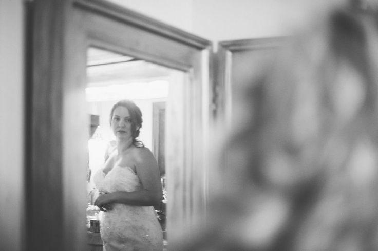 Dubsdread Wedding | Bride looking at her reflection | Rudy & Marta