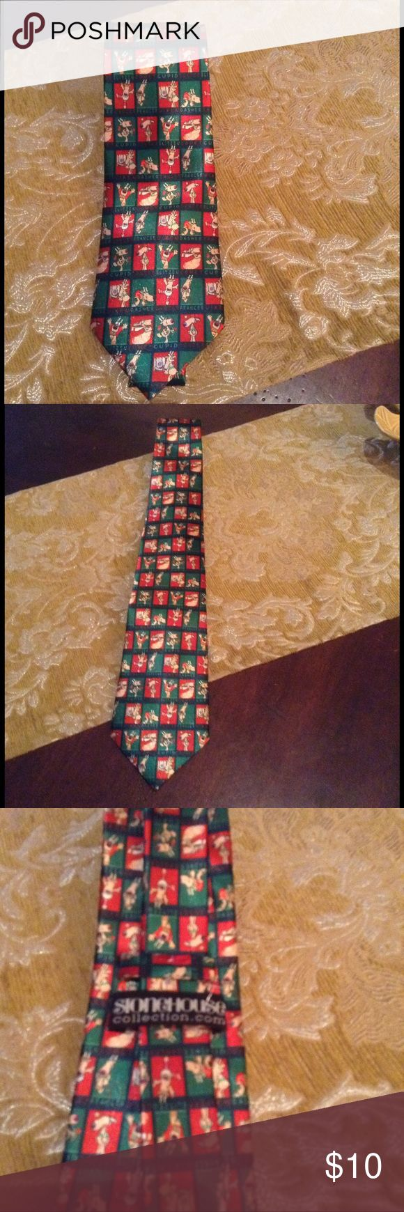 Stonehouse Collection Christmas Tie This green & red background tie has all of the Christmas reindeers on it with their names.  It has other colors of tan, white, pink, purple, and black.  The tie bottom width is 3.5 inches & the length is 58 inches.  100% Polyester.  Perfect for the holidays!!! Stonehouse Collection Accessories Ties