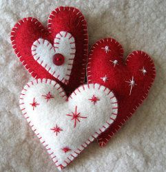 DIY Heart felt ornaments plus 5 more ideas in a free downloadable eBook. The embroidered stars dress them up for Christmas, but leave them off and the hearts would also make great Valentine's Day crafts.