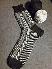 These socks are initially designed for my husband. He loves knitted socks and I like designing and knitting them for him.