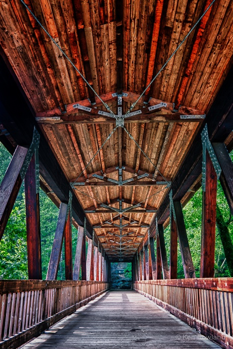 This bridge is the Vickery Creek covered bridge in the Old Mill Park in Roswell, Georgia.