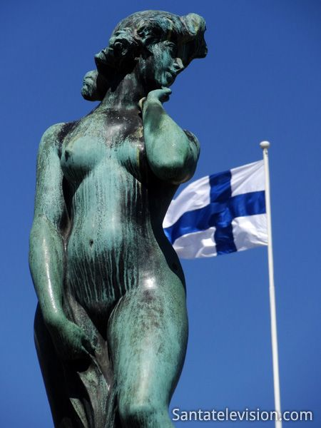 The Havis Amanda statue near the Market sale and the President's residence; Havis Amanda symbolizes Helsinki rising up from the sea.
