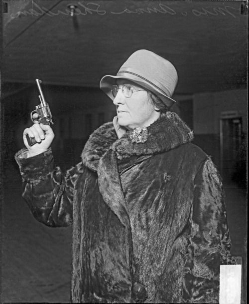 Small numbers of women joined the police ranks in the 1920s. Shown here is Chicago policewoman Anna Sheridan, with pistol, in 1928.