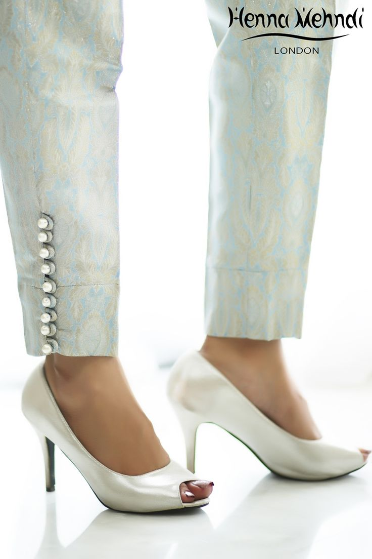 Blue jamavaar cigarette trousers with pearl buttons on sides.