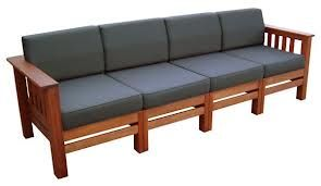 Timber seat with black cushions