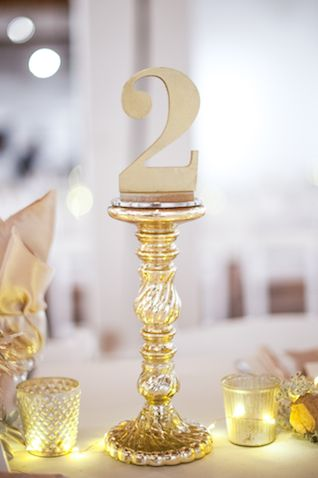 Gold candlestick table numbers | Liane V Bergen Photography | see more on: http://burnettsboards.com/2014/12/minimalist-nye-wedding/