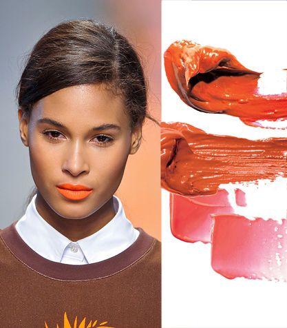 Il rossetto arancio sulla pelle scura