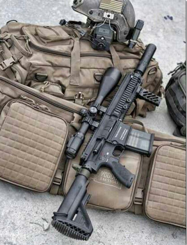 Short barrel HK 417 with suppresor and high power scope.