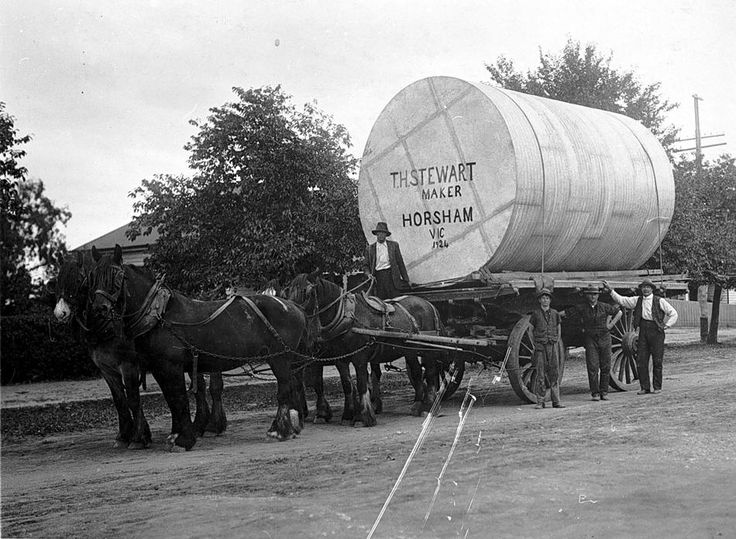 A water tank constructed by T.H. Stewart, Horsham being transported to 'Fairy Hill' near Lower Norton by a horse-drawn wagon in 1924.