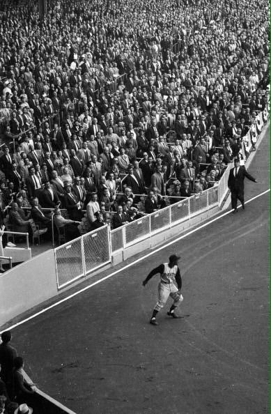 Roberto Clemente gets ball back to infield during the 1960 Pirates - Yankees World Series at Yankee Stadium.