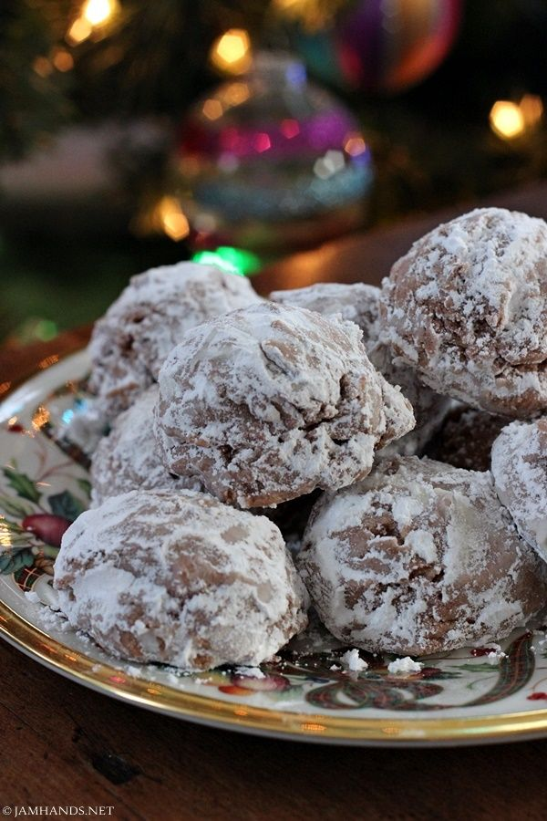 Hot Chocolate Snowballs ~ These delicious cookies are made with hot chocolate mix. You can use a plain mix or jazz it up by using a flavored hot chocolate mix like peppermint. They also have a bit of cream cheese mixed into the dough, giving them a great flavor and texture. Makes 20 cookies