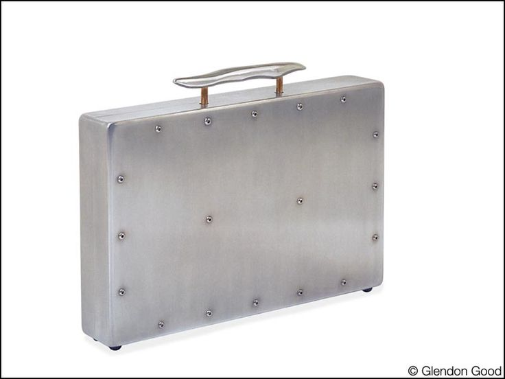 Custom made briefcase fabricated with satin polished aluminum, copper rods, leather padded interior.