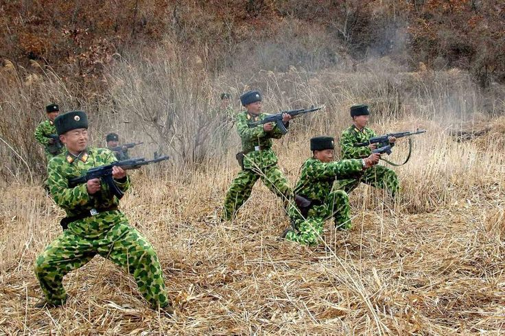 North Korean soldiers with weapons attend military training in an undisclosed location in this picture released by the North's official KCNA news agency on March 11, 2013. REUTERS/KCNA