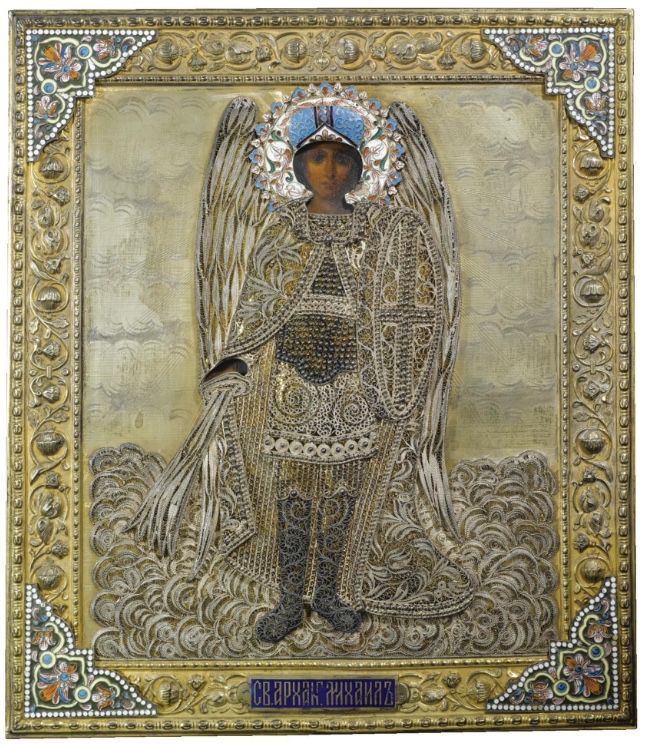 The Dimitri Mavrommatis Collection - The Saint Archangel Mikhail, Moscow, 1899-1908, held in a silver-gilt oklad, the St. Mikhail painted in oil, withsilver filigree wings, dressed in robes and with vari-coloured cloisonné enamel halo, the border cast and chased with scrolling foliage and set to each corner with enamelled friezeswithin white beaded borders and applied with plaque with inscription in Cyrillic, with workmaster's initials, 84 standard. Price realized $61,644 USD