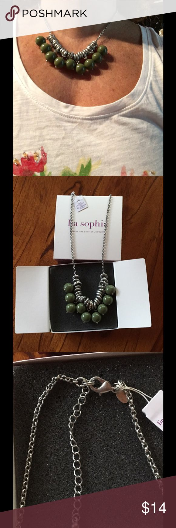 PRICE DROP! Lia Sophia Statement Necklace Brand new Lia Sophia necklace with moving olive green beads. Accented with three crystal rings. Lobster claw clasp and several loops to adjust length. Lia Sophia Jewelry Necklaces