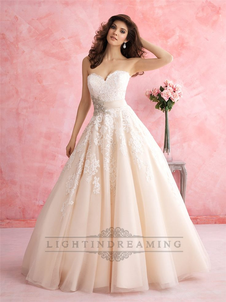 This ballgown is for the lover of all things feminine. It features a floral patterned lace, tulle and a gorgeous crystal accent.