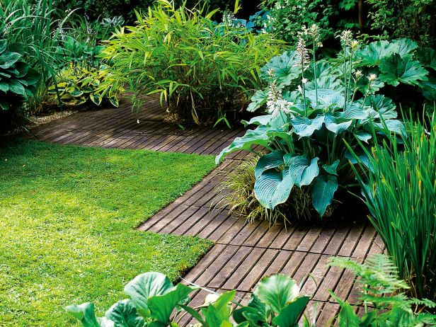 Decking lumber is used as ground level edging against a manicured lawn. Decks are an option for a garden design where otherwise there is no usable space. It can be tied to a building or a freestanding surfacing material.
