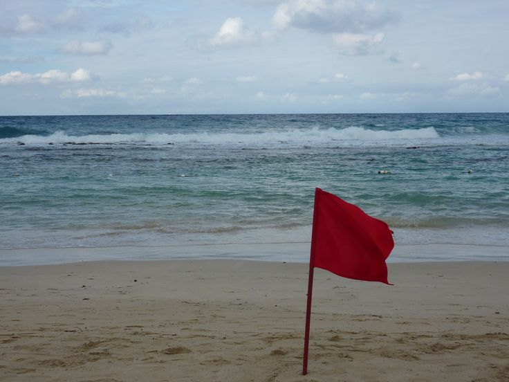 When the red flags are out that means the ocean is closed. Time to go find something else to do. Did someone say swim up pool bar?!