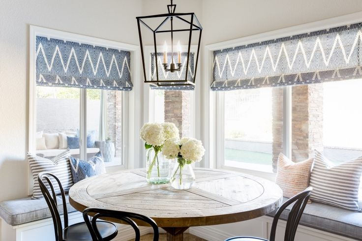 a sunny breakfast nook with lots of pattern play Photography : John Woodcock Read More on SMP: http://www.stylemepretty.com/living/2016/09/07/you-would-never-guess-that-3-kids-live-in-this-home/