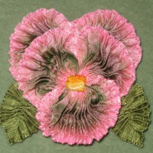 I ❤ ribbonwork . . . Ruched ribbon pansy- Ribbon pansy is made using French ombre ribbon that has been pleated into petals. Pansy features vintage ribbon leaves on cloth covered wire , and is 2 3/4 by 2 1/2 inches in diameter.