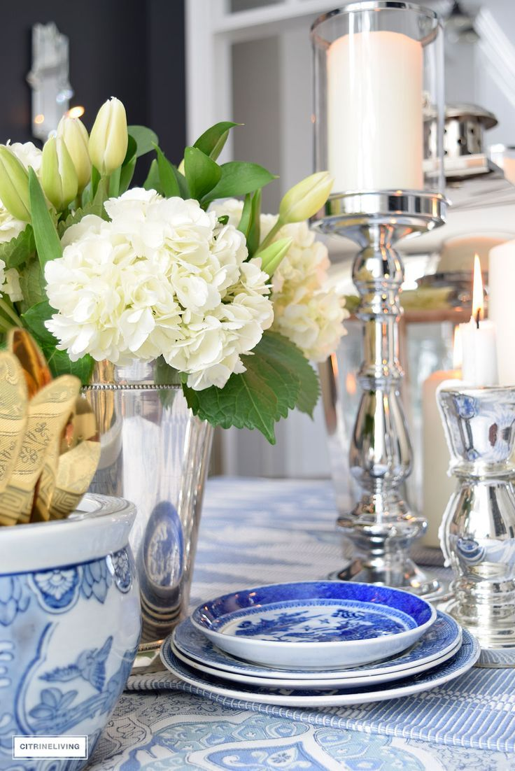 Fresh flowers and layers of blue and white pattern with silver candleholders and gold flatware is perfect for a Spring table. (scheduled via http://www.tailwindapp.com?utm_source=pinterest&utm_medium=twpin&utm_content=post157478191&utm_campaign=scheduler_attribution)