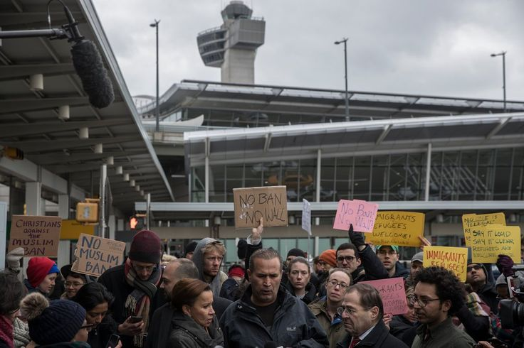 Hameed%20Khalid%20Darweesh,%20center,%20from%20Iraq,%20was%20detained%20at%20Kennedy%20Airport%20for%20nearly%2019%20hours%C2%A0before%20being%20granted%20a%20waiver%20on%20Saturday.