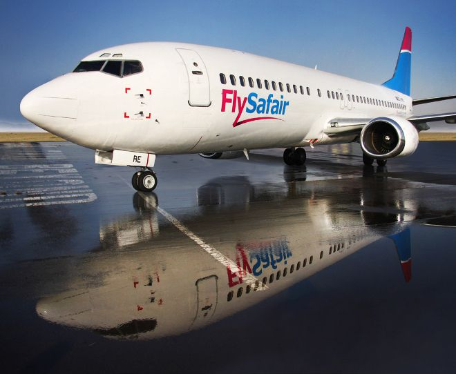 FlySafair Jet with a reflection on the tarmac