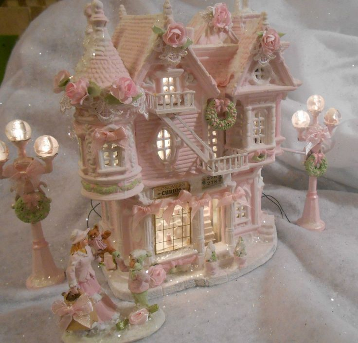 Love this.  It's almost like the Pink Gingerbread house I found at Goodwill a…