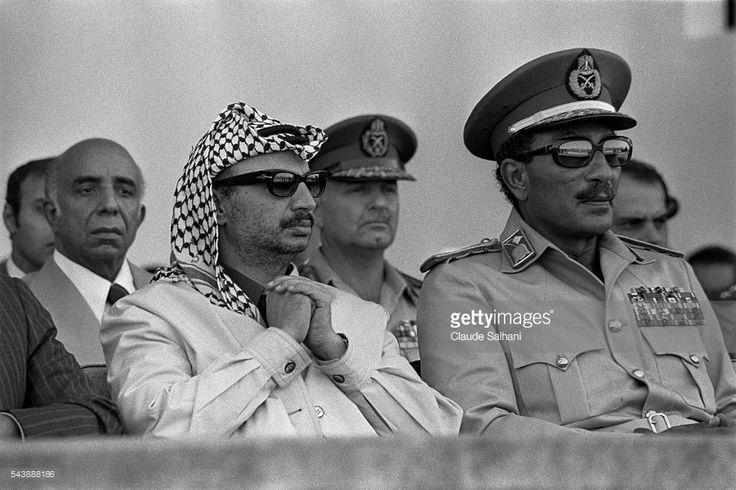 السادات وياسر عرفات Chairman of the Palestine Liberation Organization (PLO) Yasser Arafat and President of the Republic of Egypt Anwar Al Sadat attend a celebration in honor of the 1st anniversary of the Yom Kippur War.