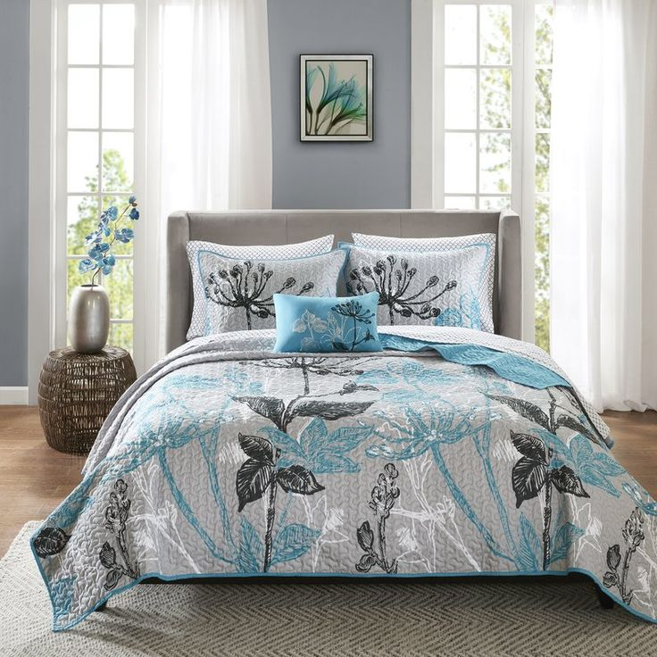 Give your mattress an eclectic makeover with this charismatic coverlet set. Made from plush polyester, this machine washable set includes one coverlet and two shams in a funky floral motif with decorative stitching and contrast piping, one flat sheet, one fitted sheet, and two pillowcases in a geometric trellis print, and one decorative aqua-hued accent pillow. To create a contemporary aesthetic in your master suite, start by rolling out a chevron area rug to define the space, then place a…