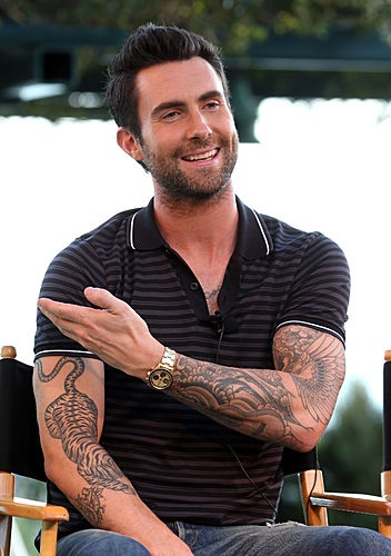 Adam Levine  - love, love the tiger - hope he doesn't tattoo around it - let it stand alone - awesome piece of work worthy of  stand alone status
