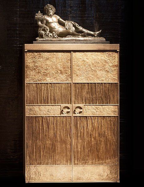 Displayed atop a gilded-bronze box by Marino is a circa-1700 French bronze.