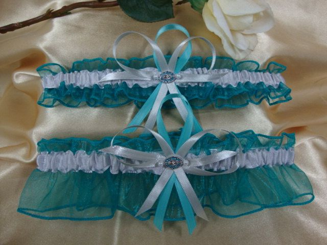 Teal and Silver Wedding Garter Set with Teal Crystal Deco. $29.95, via Etsy.