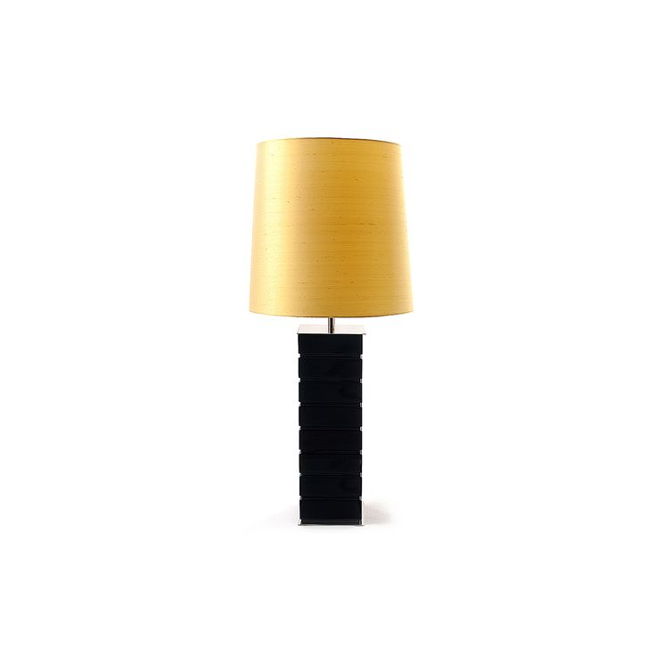 ALLEY is a floor lamp finely carved wood based with a stainless steel plate on top and bottom.