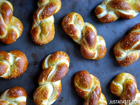 You don't have to fly to Germanyor even attend anOktoberfest party to get the authentic experience. Channel the spirit of a Bavarian beer hallat home with this recipe for homemade soft pretzels. Start yourfrom-scratch dough withyeast, sugar, white flour, baking soda and butter, leaving time to let it rest and double in size. When the dough isready, roll each piece into a rope and form it into a pretzel shape. (Perfect pretzel tip: Make a smiley face holding the ends of the rope, cross…